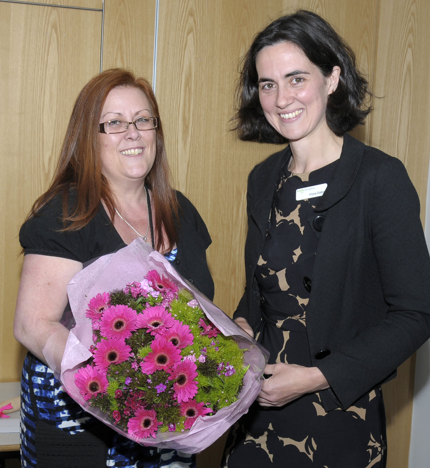 Lynda (left) receiving her flowers at the VQ Presentation evening