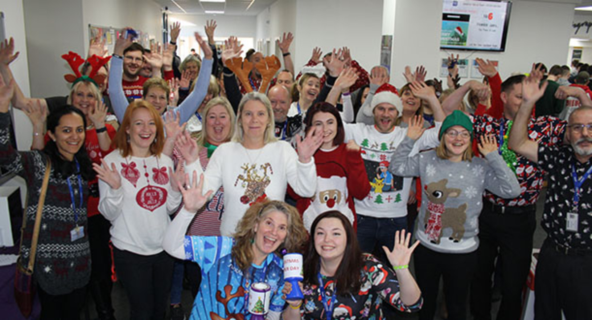 Eastleigh College Staff get in the festive spirit for Christmas Jumper Day in aid of Child Bereavement UK
