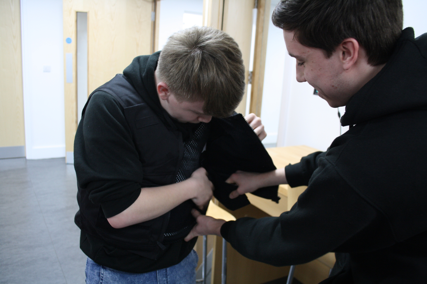 Students try on the Cordura vest