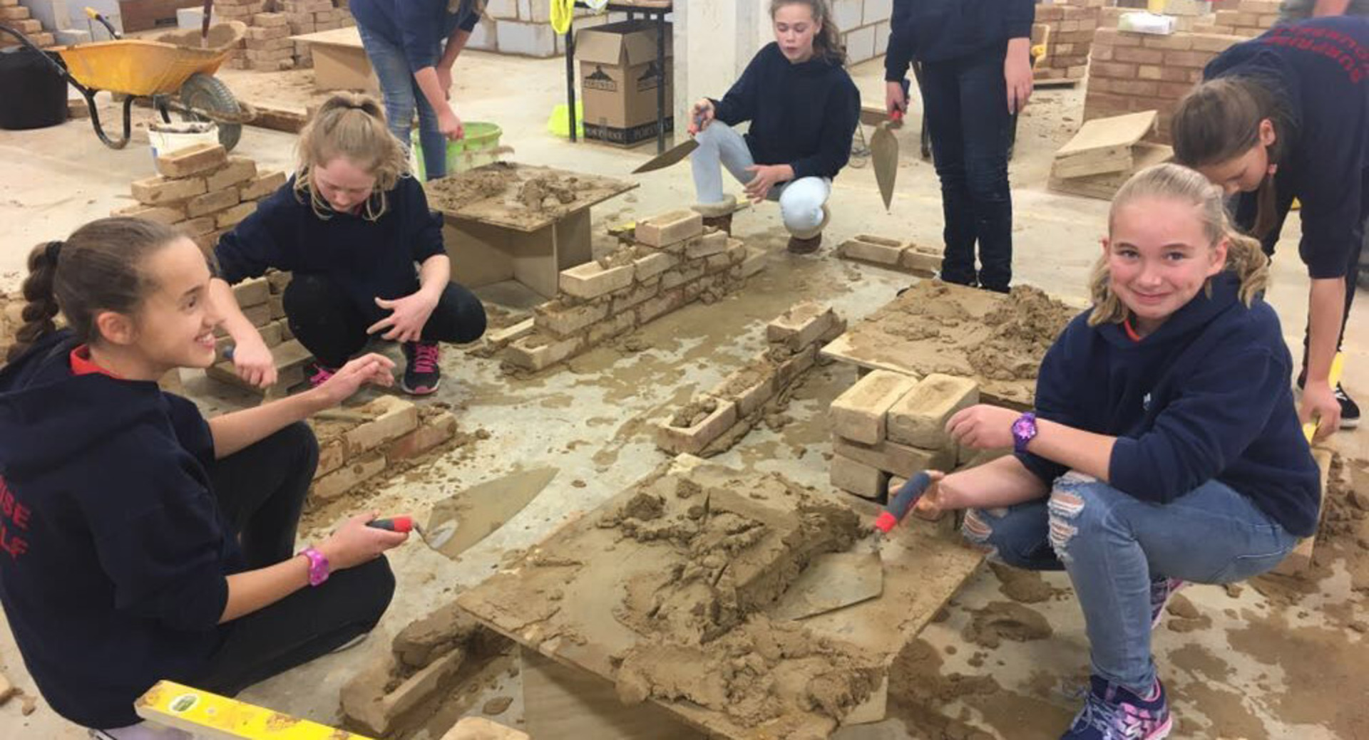 Girl Guides try their hand in Brickwork and Carpentry workshops